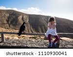 sorrowful little girl with... | Shutterstock . vector #1110930041