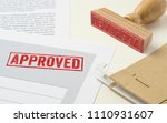 a red stamp on a document  ... | Shutterstock . vector #1110931607