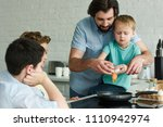 family cooking eggs for... | Shutterstock . vector #1110942974