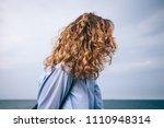 side view female's head on blue ... | Shutterstock . vector #1110948314