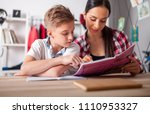 mother helping her son with... | Shutterstock . vector #1110953327