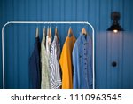 clothes hang on wooden coat... | Shutterstock . vector #1110963545