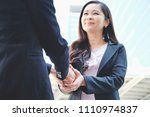 businesswoman giving handshake... | Shutterstock . vector #1110974837
