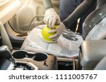 A Man Cleaning Car Interior By...