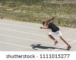 young male sprinter taking off... | Shutterstock . vector #1111015277