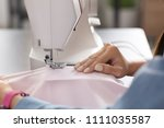 young female tailor using... | Shutterstock . vector #1111035587