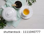 Cup With Tea And Teapot On...