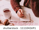 female writing in diary with... | Shutterstock . vector #1111042691