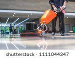 cleaning floor with machine | Shutterstock . vector #1111044347