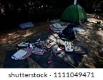 Small photo of Refugees and migrants in a makeshift camp at Pedion tou Areos park where some 1500 migrants and refugees live in a makeshift camps in Athens, Greece on Aug. 16, 2015