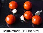 tomatoes and garlic on a oven...   Shutterstock . vector #1111054391