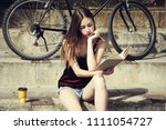 girl with book sitting on stairs   Shutterstock . vector #1111054727