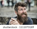hipster with long beard looks... | Shutterstock . vector #1111073189