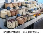 Small photo of Several kinds of halva of different flavors on an iron counter.
