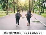 two pupils of primary school... | Shutterstock . vector #1111102994