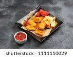 chicken nuggets with french...   Shutterstock . vector #1111110029