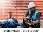asian engineer checking list... | Shutterstock . vector #1111127084