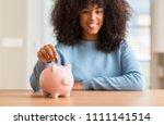 african american woman saves... | Shutterstock . vector #1111141514