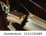 books hung to decorate an... | Shutterstock . vector #1111152689