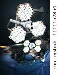 working surgeons under the... | Shutterstock . vector #1111152854
