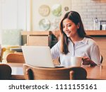 asain woman working with laptop ... | Shutterstock . vector #1111155161
