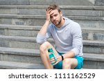 working out on stairs. man... | Shutterstock . vector #1111162529