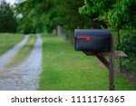 a large mailbox with the flag... | Shutterstock . vector #1111176365