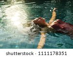 attractive female floating on... | Shutterstock . vector #1111178351
