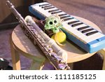 Small photo of wind instrumental keyboard next to the trumpet and skull, before the concert