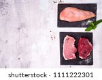 Small photo of Fresh raw meat - beef, pork and chicken on dark slate cutting board. Lean proteins. Lean proteins.