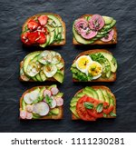avocado sandwiches  toasts with ... | Shutterstock . vector #1111230281