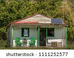 green painted rocking chairs on ... | Shutterstock . vector #1111252577