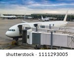 loading passengers in aircraft... | Shutterstock . vector #1111293005