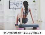 rear view of young woman doing... | Shutterstock . vector #1111298615