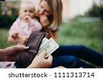 earning money for family. male... | Shutterstock . vector #1111313714
