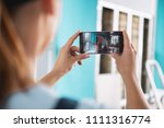 photographing. skilled... | Shutterstock . vector #1111316774