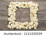 bouquet frame of white roses on ... | Shutterstock . vector #1111320539