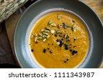 pumpkin cream soup with seeds | Shutterstock . vector #1111343987