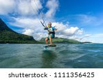professional kiter t rides by... | Shutterstock . vector #1111356425