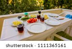 the summer breakfast table on... | Shutterstock . vector #1111365161
