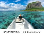 man drives a snow white boat in ... | Shutterstock . vector #1111383179