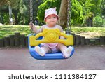 cute adorable baby girl playing ... | Shutterstock . vector #1111384127