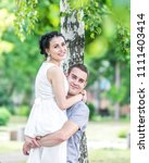 portrait of young couple female ... | Shutterstock . vector #1111403414