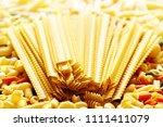 long yellow italian pasta close ... | Shutterstock . vector #1111411079