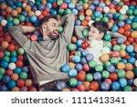 top view. joyfull dad and son...   Shutterstock . vector #1111413341