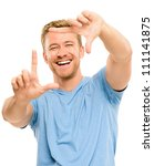 Closeup of confident happy man framing photograph white background - stock photo
