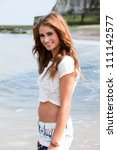 young woman walking in sea at...   Shutterstock . vector #111142577