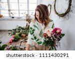 florist makes a bouquet. | Shutterstock . vector #1111430291