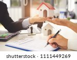 real estate agent holding a... | Shutterstock . vector #1111449269