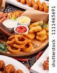 beer snacks close up. grilled... | Shutterstock . vector #1111465691